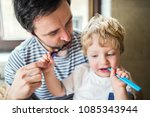 father brushing his teeth with... | Shutterstock . vector #1085343944