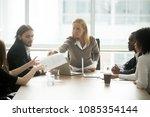 serious businesswoman handing... | Shutterstock . vector #1085354144