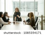 serious woman boss scolding... | Shutterstock . vector #1085354171
