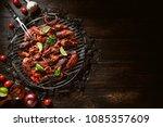 chicken wings of barbecue in... | Shutterstock . vector #1085357609