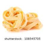 Italian pasta fettuccine nest isolated on white background - stock photo
