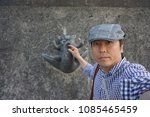 a man in front of pottery cat...   Shutterstock . vector #1085465459
