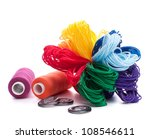 Sewing accessories isolated on white background cutout - stock photo