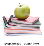Notebook stack and apple. Schoolchild and student studies accessories. Back to school concept. - stock photo