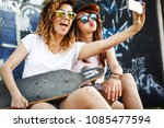 two female skaters friends... | Shutterstock . vector #1085477594