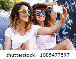 two female skaters friends...   Shutterstock . vector #1085477597