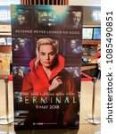 Small photo of KUALA LUMPUR, MALAYSIA - MARCH 4, 2018: Terminal movie poster, is an upcoming heist thriller film written and directed by Vaughn Stein. The film stars Margot Robbie