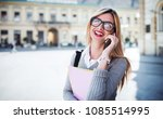 young smiling woman talking on... | Shutterstock . vector #1085514995