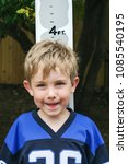 young boy measuring his height... | Shutterstock . vector #1085540195