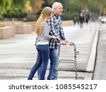young woman helping elderly man ... | Shutterstock . vector #1085545217