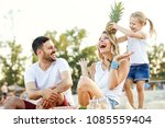 happy family on the beach... | Shutterstock . vector #1085559404
