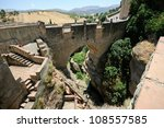 Roman bridge in Ronda, one of the famous white villages in M�¡laga, Andalusia, Spain - stock photo