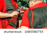 Small photo of two hunters in special clothing consider a shotgun