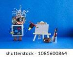 kindly robot artist begins to...   Shutterstock . vector #1085600864