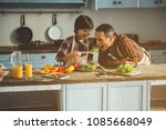 man and his son cooking with... | Shutterstock . vector #1085668049