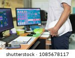 a man holding a staff safety... | Shutterstock . vector #1085678117