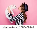 Stock photo side view half face profile portrait of attractive pretty charming girl raise dog in front of 1085680961