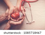 child and adult holding red... | Shutterstock . vector #1085718467