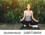 woman practicing yoga in green...   Shutterstock . vector #1085728604