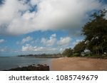 Small photo of Curving shore of the beach at Kapaa Shores of the Island of Kauai in Hawaii.