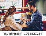 bearded young man explaining... | Shutterstock . vector #1085821259