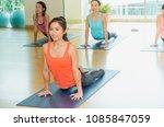 yoga class in studio room group ...   Shutterstock . vector #1085847059