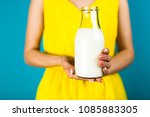 woman holding a bottle of milk | Shutterstock . vector #1085883305