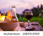 glass of red wine on table in... | Shutterstock . vector #1085915909