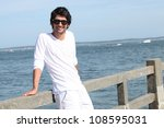 man stood on jetty | Shutterstock . vector #108595031