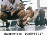 male personal trainer sitting... | Shutterstock . vector #1085955317