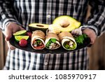 man with snacks and dips.... | Shutterstock . vector #1085970917