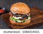 fresh tasty burger on wood table   Shutterstock . vector #1086014021