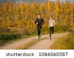 young  beautiful couple runs on ... | Shutterstock . vector #1086060587