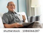 happy asian senior man smiling... | Shutterstock . vector #1086066287