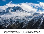 a snow capped mountain peak in... | Shutterstock . vector #1086075935