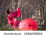 asia woman with kimono and red... | Shutterstock . vector #1086098804