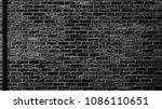 Black Brick Wall With Drain...