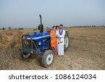 rural indian family standing...   Shutterstock . vector #1086124034