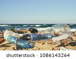 spilled garbage on the beach of ... | Shutterstock . vector #1086143264