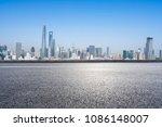 empty asphalt road with city... | Shutterstock . vector #1086148007