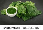 fresh baby spinach leaves.... | Shutterstock . vector #1086160409