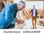 carpenters at work ... | Shutterstock . vector #1086165809
