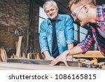 carpenters using circular saw... | Shutterstock . vector #1086165815