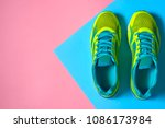 Pair Of Sport Shoes On Colorfu...