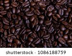 Whole roasted coffee beans with copy space - stock photo