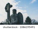 cinematic photo of angel statue | Shutterstock . vector #1086195491