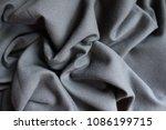Small photo of Folded simple unprinted dark grey viscose fabric