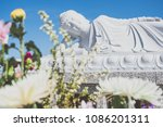 lying buddha statue in japan  | Shutterstock . vector #1086201311