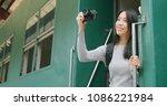 woman taking photo on digital... | Shutterstock . vector #1086221984