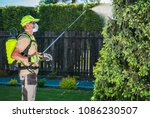 garden insecticide by spraying. ... | Shutterstock . vector #1086230507